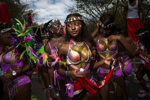 Participants wearing costumes take part in the West Indian Day Parade in the Brooklyn borough of New York September 1, 2014. (Photo by Eric Thayer/Reuters)