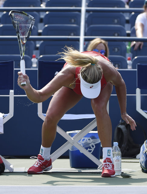 Coco Vandeweghe of the US smashes her racquet as she plays Bethany Mattek-Sands of the US during their match on the third day of the 2015 US Open Tennis Championship at the USTA National Tennis Center in Flushing Meadows, New York, USA, 02 September 2015. The US Open runs through 13 September, which is a return to a 14-day schedule. (Photo by John G. Mabanglo/EPA)