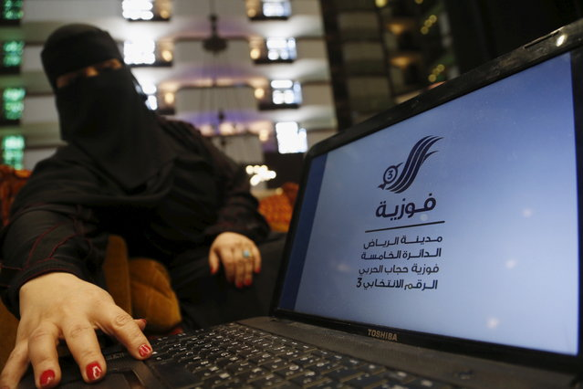 Fawzia al-Harbi, a candidate for local municipal council elections, shows her candidate biography at a shopping mall in Riyadh November 29, 2015. (Photo by Faisal Al Nasser/Reuters)