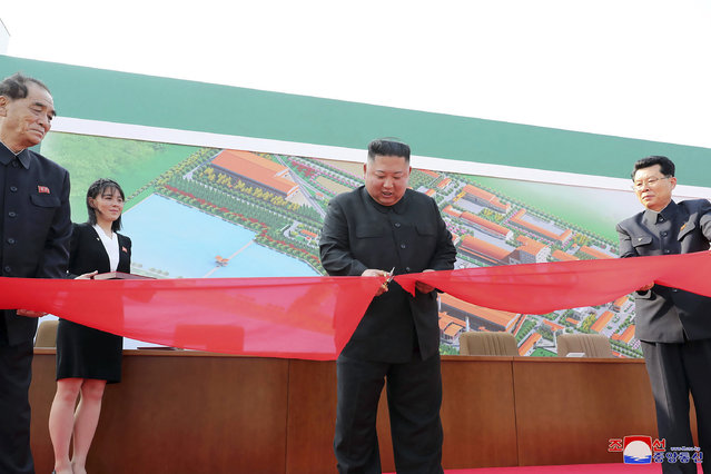 "In this Friday, May 1, 2020, photo provided by the North Korean government, North Korean leader Kim Jong Un, center, cuts a tape, watched by his sister Kim Yo Jong, during his visit to a fertilizer factory in Sunchon, South Pyongan province, near Pyongyang, North Korea. Kim made his first public appearance in 20 days as he celebrated the completion of the fertilizer factory, state media said Saturday, May 2, 2020, ending an absence that had triggered global rumors that he may be seriously ill.  Independent journalists were not given access to cover the event depicted in this image distributed by the North Korean government. The content of this image is as provided and cannot be independently verified. Korean language watermark on image as provided by source reads: ""KCNA"" which is the abbreviation for Korean Central News Agency. (Photo by Korean Central News Agency/Korea News Service via AP Photo)"
