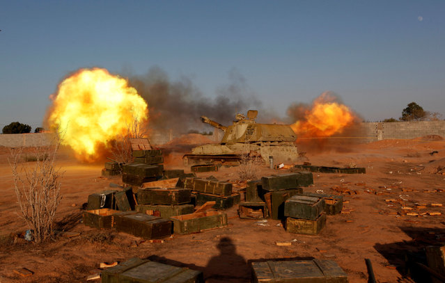 Libyan forces allied with the U.N.-backed government fire a shell at Islamic State fighters' positions in Sirte, Libya August 15, 2016. (Photo by Ismail Zitouny/Reuters)