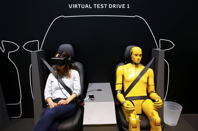 A visitor enjoys a virtual test drive at Toyota booth during the media day at the Frankfurt Motor Show (IAA) in Frankfurt, Germany, September 15, 2015. (Photo by Kai Pfaffenbach/Reuters)