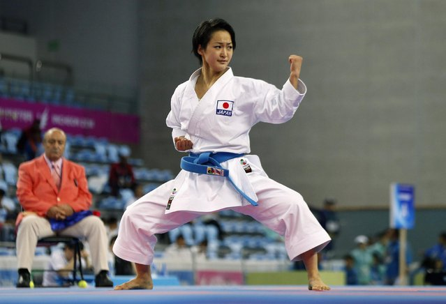 Japan's Kiyou Shimizu competes against Vietnam's Nguyen Hoang Ngan in the women's kata final of the karate competition at Gyeyang Gymnasium during the 17th Asian Games in Incheon October 2, 2014. (Photo by Jason Reed/Reuters)