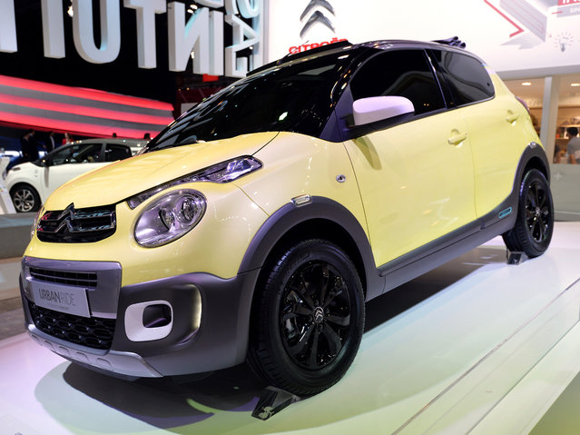 The new Citroen concept car C1 Urban Rider is presented at the 2014 Paris Auto Show on October 2, 2014 in Paris on the first of the two press days. (Photo by Miguel Medina/AFP Photo)