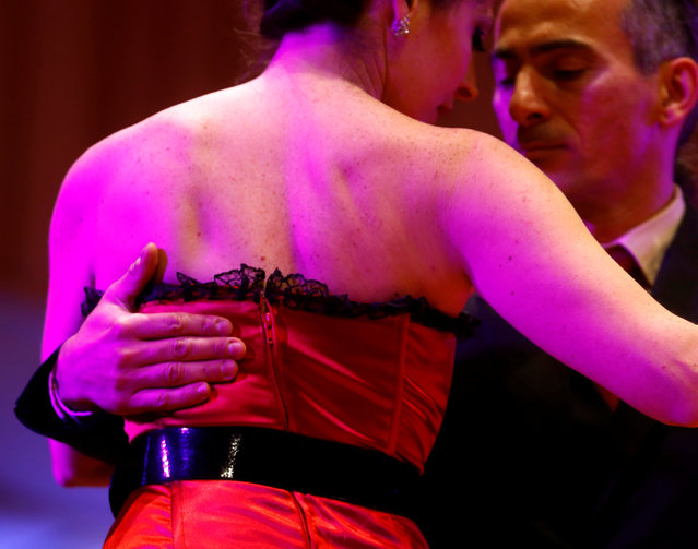 A couple competes in the Salon Tango style qualifier round at the Tango World Championship in Buenos Aires, Argentina, August 22, 2016. (Photo by Enrique Marcarian/Reuters)