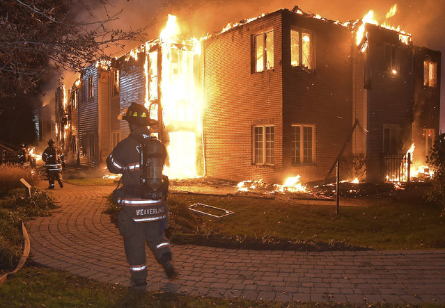 Firefighters battle a blaze at the Barclay Friends Senior Living Community in West Chester, Pa., Thursday, November 16, 2017. Chester County emergency officials say at least 20 people have been taken to area hospitals for treatment. The extent of their injuries was not immediately known. (Photo by Pete Bannan/Daily Local News via AP Photo)