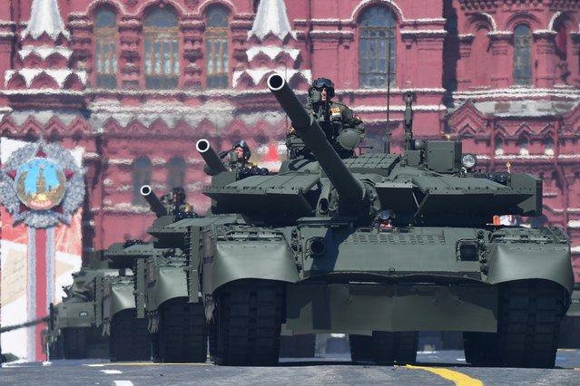 Russian T-72B3 main battle tanks drive during the Victory Day Parade in Red Square in Moscow, Russia, June 24, 2020. (Photo by Iliya Pitalev/Host Photo Agency via Reuters)
