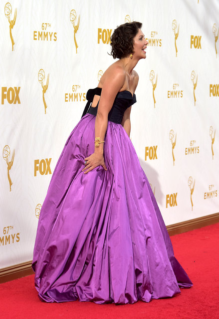 Maggie Gyllenhaal arrives at the 67th Primetime Emmy Awards on Sunday, September 20, 2015, at the Microsoft Theater in Los Angeles. (Photo by Charles Sykes/Invision for the Television Academy/AP Images)