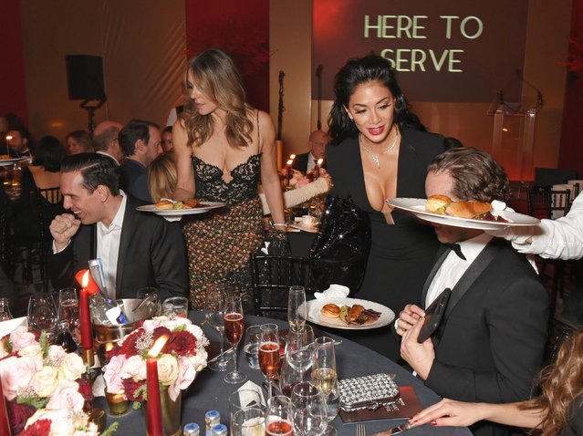 Elizabeth Hurley (2L) and Nicole Scherzinger (2R) serve dinner at the BOVET 1822 Brilliant is Beautiful Gala benefitting Artists for Peace and Justice's Global Education Fund for Women and Girls at Claridge's Hotel on December 1, 2017 in London, England. (Photo by David M. Benett/Dave Benett/Getty Images for BOVET & Artists for Peace and Justice)