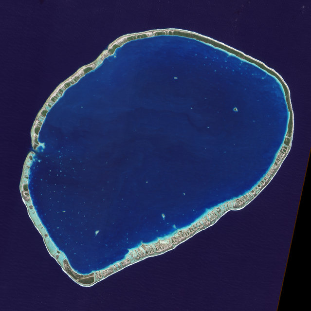 The islands and coral atolls of French Polynesia, located in the southern Pacific Ocean, epitomize the idea of tropical paradise: white sandy beaches, turquoise lagoons, and palm trees. Even from the distance of space, the view of these atolls is beautiful. This image from the Advanced Land Imager on NASA's Earth Observing-1 (EO-1) satellite shows the southern part of Tikehau Atoll, one of the 78 coral atolls that make up the Tuamotu Archipelago. Patches of coral make star-like spots across the turquoise expanse of the lagoon. A line of tree-covered islets encircles the lagoon. At the southernmost tip of the atoll, a large islet accommodates a small village and an air strip. (Photo by NASA/GSFC/USGS EROS Data Center)