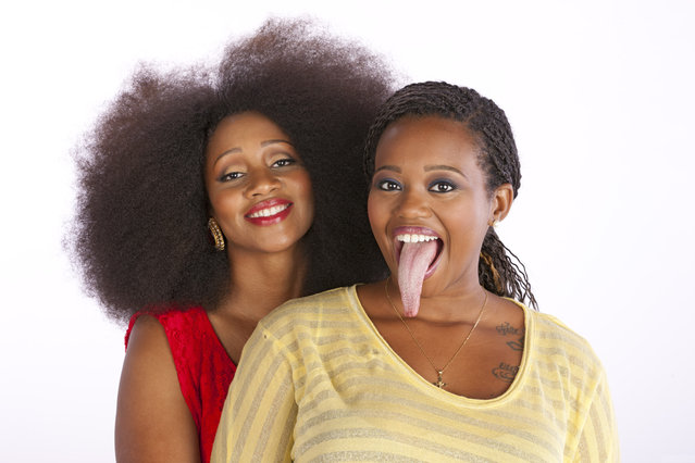 21 year-old Chanel Tapper, with the amazing tongue and 35 year-old Aevin Dugas, with the beautiful hair was certified as world record breakers for the world's longest tongue and the world's biggest afro in the Guinness Book of World Records. (Photo by Guinness World Records)