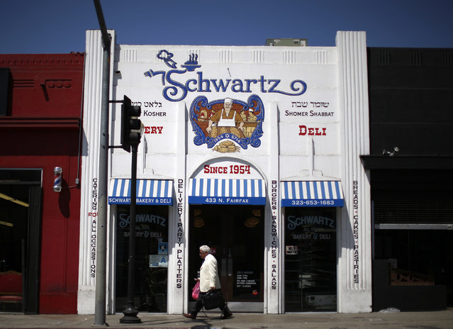 A man walks past the kosher Schwartz Bakery in the Fairfax district of Los Angeles, California August 14, 2014. (Photo by Lucy Nicholson/Reuters)