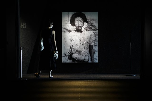 A visitor looks at photographs of the Hiroshima bombing survivors, at the Hiroshima Peace Memorial Museum in Hiroshima, Japan, 05 August 2020. On 06 August 2020 Japan will mark the 75th anniversary of the bombing of Hiroshima. In 1945 the United States dropped two nuclear bombs over the cities of Hiroshima and Nagasaki on 06 and 09 August respectively, killing more than 200,000 people. This year's annual commemoration events were either canceled or scaled down amid the ongoing coronavirus pandemic. (Photo by Dai Kurokawa/EPA/EFE)