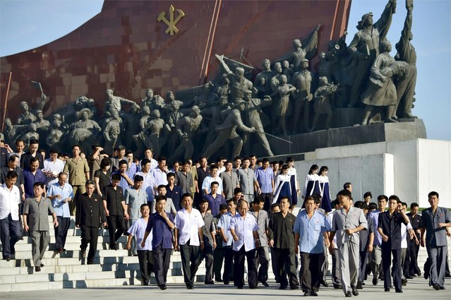 North Koreans visit Mansudae in Pyongyang, in this photo taken by Kyodo on September 9, 2015, to mark the 67th anniversary of the nation's founding. (Photo by Reuters/Kyodo)