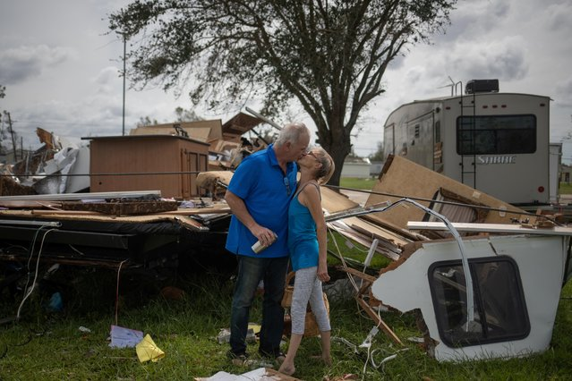 Lonnie Gatte and Teri Goleman kiss after returning to their residence, a 40-foot camping trailer, to find it completely destroyed in the aftermath of Hurricane Laura in Sulphur, Louisiana, August 27, 2020. Hurricane Laura ripped through Louisiana on Thursday, destroying buildings in towns across the southwestern corner of the state and killing four people, as one of the most powerful storms to hit the state. (Photo by Adrees Latif/Reuters)