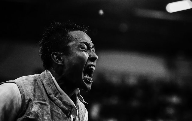 """This picture by Russian photographer Sergei Ilnitsky of the European Pressphoto Agency won the 2nd Prize in the Sports category for Sports Action Stories with """"The Golden Touch – Fencing at the Olympics"""" in the 56th World Press Photo Contest, it was announced by the organizers on 15 February 2013 in Amsterdam, The Netherlands. Yuki Ota of Japan reacts after beating Peter Joppich (unseen) of Germany in last game of the  Men's Foil Team Semi final match for the London 2012 Olympic Games in London, Britain, 05 August 2012. (Photo by Sergei Ilnitsky/EPA)"""