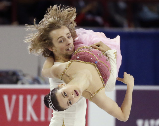 Kaitlin Hawayek and Jean-Luc Baker of the U.S. perform during the ice dance short program at the Skate America figure skating competition in Milwaukee, Wisconsin October 23, 2015. (Photo by Lucy Nicholson/Reuters)