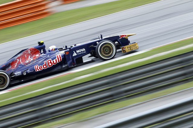 Toro Rosso Formula One driver Daniel Ricciardo of Australia drives during the second practice session of the Malaysian F1 Grand Prix at Sepang International Circuit outside Kuala Lumpur, March 22, 2013. (Photo by Samsul Said/Reuters)