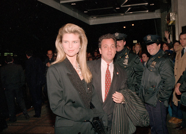 Musician Billy Joel arrives with his wife, supermodel Christie Brinkley, at New York's Waldorf Astoria Hotel for the induction ceremonies to the Rock and Roll Hall of Fame, Wednesday night, January 20, 1988. (Photo by David Bookstaver/AP Photo)