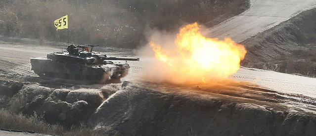 "South Korean soldiers from an armored unit participate in a field firing in  Pocheon, 46 km (28 miles) northeast of Seoul and about 15 km (9 miles) south of the demilitarized zone separating the two Koreas, March 27, 2013. North Korea is to cut the last channel of communications with South Korea because war could break out at ""any moment"", it said on Wednesday, days of after warning the United States and South Korea of nuclear attack. (Photo by Lim Byong-sik/Reuters)"