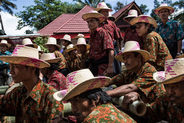 Men gather to perform a Ma'Badong dance during the Rambu Solo of V.T Sarangullo on August 26, 2016. (Photo by Agung Parameswara/The Washington Post)