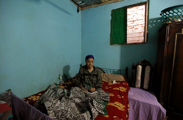 Saeda Seadawy sits on her bed in her home in Ezbet Khairallah in Cairo, Egypt October 4, 2016. (Photo by Mohamed Abd El Ghany/Reuters)