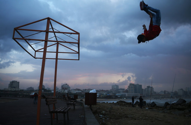 A Palestinian youth makes a jump near the beach in Gaza City on November 9, 2015. (Photo by Mohammed Abed/AFP Photo)