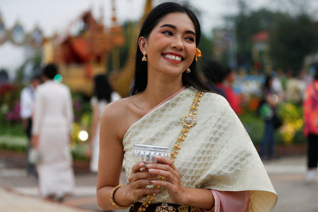 A woman dressed in traditional costume smiles at the Royal Plaza, as interest for historical clothing rises within the country, in Bangkok, Thailand April 6, 2018. (Photo by Soe Zeya Tun/Reuters)