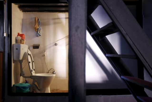 """A domestic toilet is seen inside a house in Lalitpur, Nepal, October 8, 2015. Some 2.4 billion people around the world don't have access to decent sanitation and more than a billion are forced to defecate in the open, risking disease and other dangers, according to the United Nations. The UN says that while there is sufficient fresh water on the planet for everyone, """"bad economics and poor infrastructure"""" mean that every year millions of people – most of them children – die from diseases linked to poor sanitation, unhygienic living conditions and lack of clean water supplies. (Photo by Navesh Chitrakar/Reuters)"""