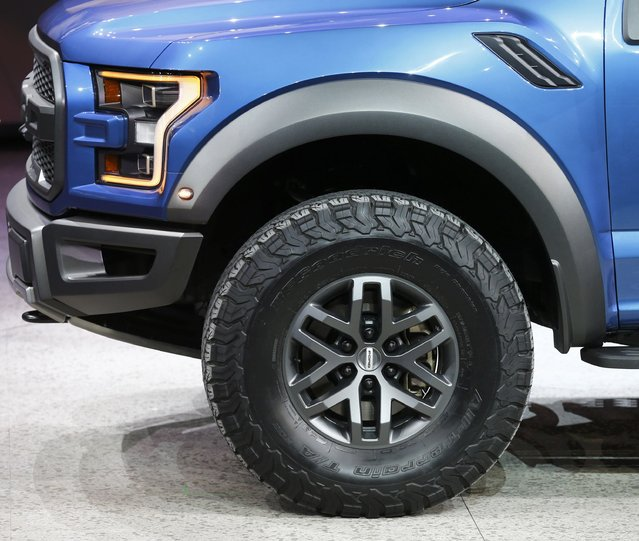 Front quarter view of a Ford Raptor pickup truck as it is displayed during the first press preview day of the North American International Auto Show in Detroit, Michigan, January 12, 2015. (Photo by Mark Blinch/Reuters)