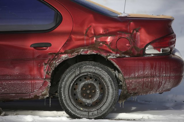 A Plymouth Breeze with rust spots sits parked in the snow in Detroit, Michigan January 10, 2015. (Photo by Joshua Lott/Reuters)