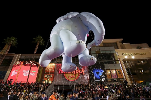 An elephant balloon floats down Hollywood Boulevard at the 84th Annual Hollywood Christmas Parade in the Hollywood section of Los Angeles, California, November 29, 2015. (Photo by David McNew/Reuters)