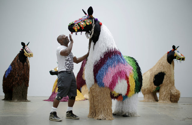 American artist Nick Cave talks to dancers dressed as a horse as he presents his first major work shown in Australia, entitled HEARD.SYD in Sydney, November 8, 2016. (Photo by Jason Reed/Reuters)