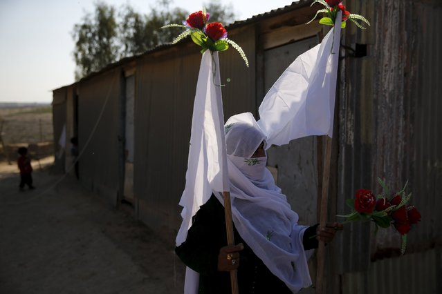 Harba, mother of Uda Tarrabin, holds decorations for a tent erected to welcome the release of her son, in the Tarrabin tribe's village near the Bedouin town of Rahat in southern Israel December 10, 2015. Egypt has freed Tarrabin, an Israeli-Arab held in its jails for 15 years on espionage charges in exchange for the release of two Egyptians held in Israel, Egyptian and Israeli officials said on Thursday. (Photo by Amir Cohen/Reuters)