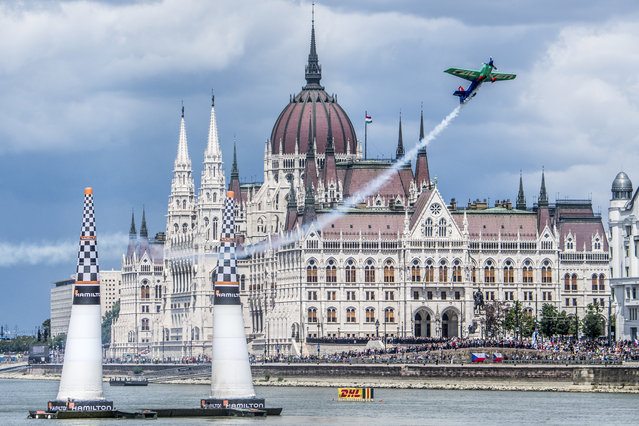 Yoshihide Muroya of Japan performs during qualifying day at the fourth round of the Red Bull Air Race World Championship in Budapest, Hungary on June 23, 2018. Thousands of Czech fans went wild on the banks of the Danube during the Red Bull Air Race in Budapest on Saturday, June 23 as their home hero Martin Sonka blazed to a Qualifying win over his fierce rival Yoshihide Muroya of Japan by a tiny 0.032 of a second. Another Czech pilot, Petr Kopfstein, was right in the hunt at third. 2016 World Champion Matthias Dolderer of Germany was not able to fly in Saturday's Qualifying due to medical reasons and will not be taking part in the Red Bull Air Race in Hungary. (Photo by Predrag Vuckovic/Red Bull Content Pool via AP Images)