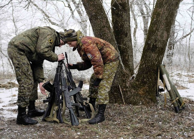 Students from the General Yermolov Cadet School stack their educational weapons during a field exercise outside the south Russian city of Stavropol January 25, 2015. (Photo by Eduard Korniyenko/Reuters)