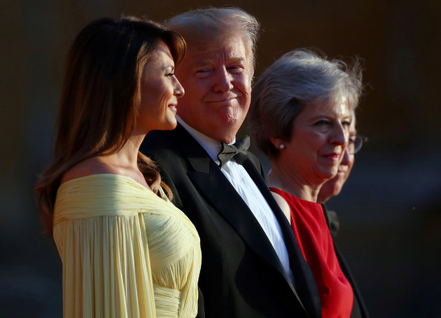 British Prime Minster Theresa May and her husband Philip stand together with U.S. President Donald Trump and first lady Melania Trump at the entrance to Blenheim Palace, July 12, 2018. (Photo by Hannah McKay/Reuters)