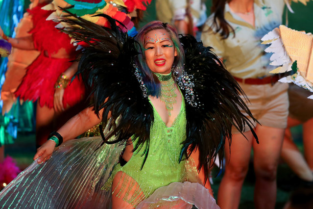 """Parade goers take part during the 43rd Sydney Gay and Lesbian Mardi Gras Parade at the SCG on March 06, 2021 in Sydney, Australia. The Sydney Gay and Lesbian Mardi Gras parade usually happens along Oxford Street but is being held at the Sydney Cricket Ground this year due to COVID-19 restrictions and contact tracing requirements. The Sydney Mardi Gras parade began in 1978 as a march and commemoration of the 1969 Stonewall Riots of New York. It is an annual event promoting awareness of gay, lesbian, bisexual and transgender issues and themes. The 2021 Mardi Gras festival theme is """"RISE"""" and is about letting spirits soar after the challenge and hardship that 2020 presented. (Photo by Brendon Thorne/Getty Images)"""