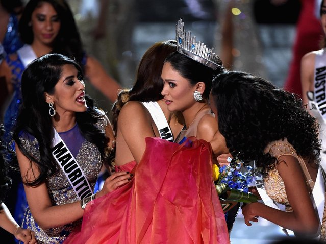 Miss Philippines 2015, Pia Alonzo Wurtzbach (2nd R), who was mistakenly named as First Runner-up reacts with other contestants after being named the 2015 Miss Universe during the 2015 Miss Universe Pageant at The Axis at Planet Hollywood Resort & Casino on December 20, 2015 in Las Vegas, Nevada. (Photo by Ethan Miller/Getty Images)