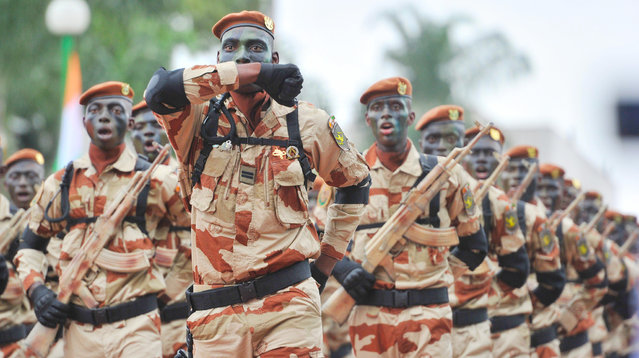 The members of Ivory Coast's special forces march, on August 7, 2013, at the presidential palace in Abidjan during celebrations marking the 53nd anniversairy of the country's independence from France. (Photo by Issouf Sanogo/AFP Photo)