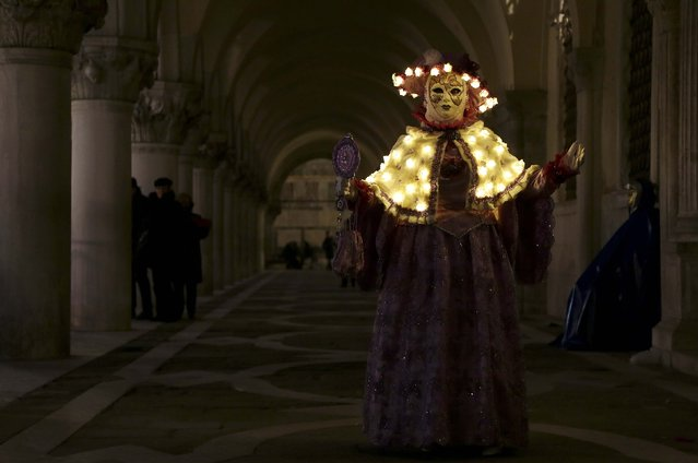 A masked reveller poses in St. Mark's Square during the Venice Carnival, February 7, 2015. (Photo by Stefano Rellandini/Reuters)
