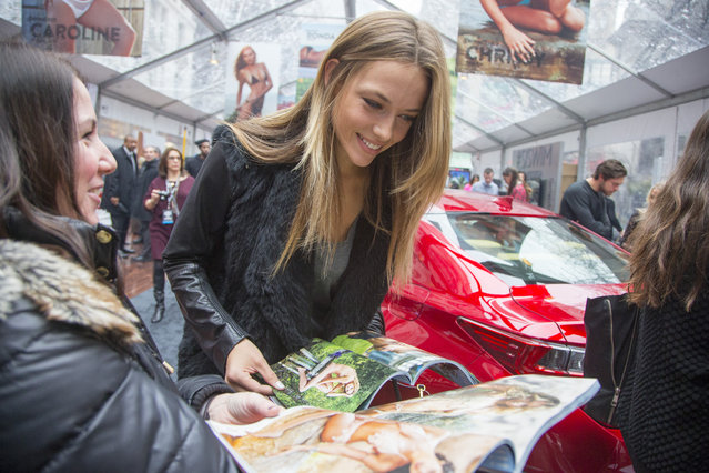 Sports Illustrated swimsuit model Hannah Ferguson checks out her photos in the 2015 Sports Illustrated swimsuit issue during the SwimCity festival in New York City on Monday February 9, 2015. (Photo by Gordon Donovan/Yahoo News)
