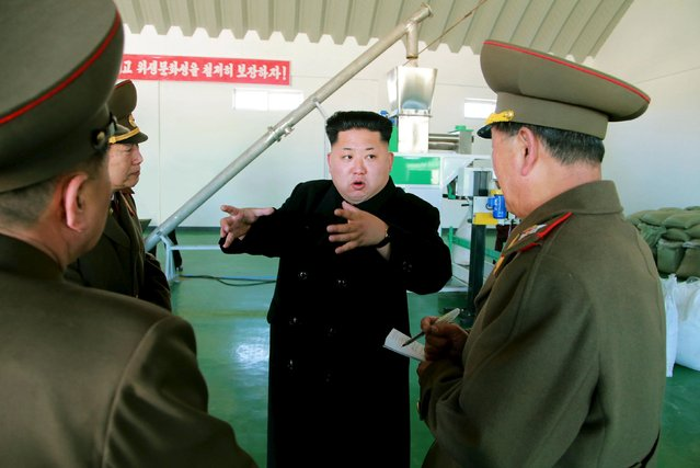 North Korean leader Kim Jong Un gives field guidance at a fish meal fodder factory, newly built by the Korean People's Army (KPA) in this undated photo released by North Korea's Korean Central News Agency (KCNA) in Pyongyang March 24, 2015. (Photo by Reuters/KCNA)