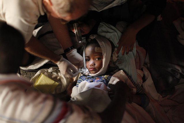 An injured child receives medical treatment after an earthquake in Port-au-Prince in this January 13, 2010 file photo. The 7.0 magnitude quake rocked Haiti, killing thousands of people as it toppled the presidential palace and hillside shanties alike and leaving the poor Caribbean nation appealing for international help. (Photo by Eduardo Munoz/Reuters)