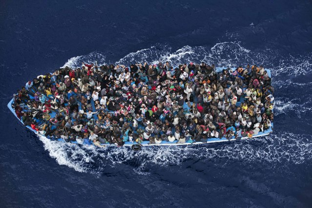 Massimo Sestini, an Italian photographer, won the Second Prize in the General News Category, Singles, of the 2015 World Press Photo contest with this image of shipwrecked people being rescued aboard a boat 32 km (20 miles) north of Libya by a frigate of the Italian navy in this picture taken June 7, 2014, and released by the World Press Photo on February 12, 2015. (Photo by Massimo Sestini/Reuters/World Press Photo)