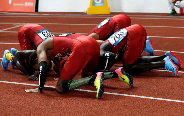 The Qatar men' s 4x400 m relay team celebrate after winning the gold medal during the athletics competition at the 18 th Asian Games in Jakarta, Indonesia, Thursday, August 30, 2018. (Photo by Issei Kato/Reuters)