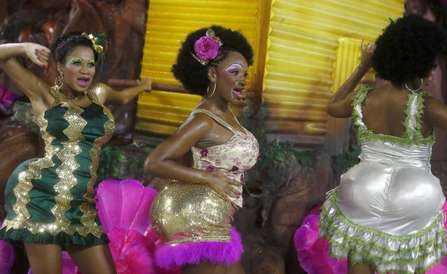 Revellers from the Mangueira samba school participate in the annual carnival parade in Rio de Janeiro's Sambadrome, February 15, 2015. (Photo by Pilar Olivares/Reuters)
