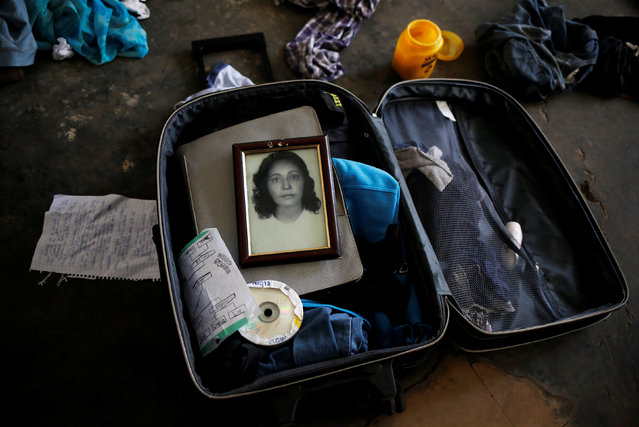 A photograph of the grandmother of Teflon, who is among members of lesbian, gay, bisexual and transgender (LGBT) community, that have been invited to live in a building that the roofless movement has occupied, lies in Teflon's suitcase, in downtown Sao Paulo, Brazil, November 8, 2016. (Photo by Nacho Doce/Reuters)