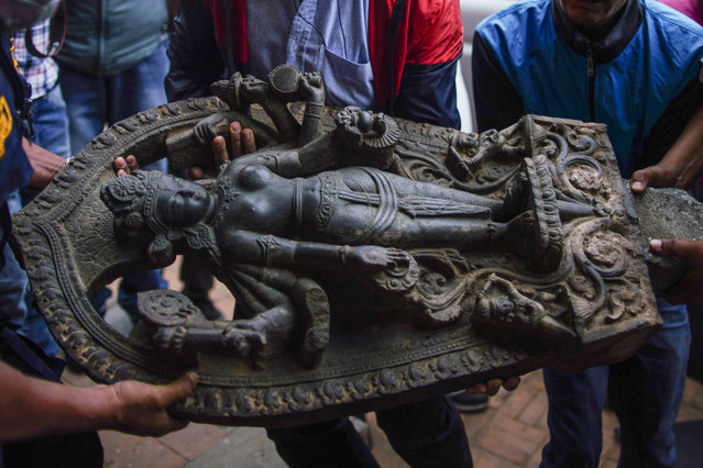A figure of Laxmi Narayan that was stolen in 1984 is brought to Patan Durbar Square by officials from the Department of Archeology in Lalitpur, Nepal on Friday, April 16, 2021. The idol was worshipped at Patan till 1984 and went missing which was later traced to a museum in USA. (Photo by Skanda Gautam/ZUMA Wire/Rex Features/Shutterstock)