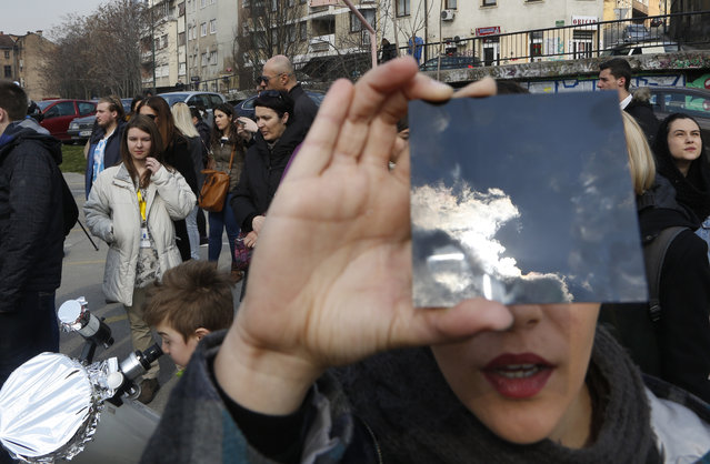 A solar eclipse is seen through a dark glass plate in Sarajevo, Bosnia, on Friday , March 20, 2015. Solar eclipse is darkening parts of Europe on Friday in a rare solar event that won't be repeated for more than a decade. (Photo by Amel Emric/AP Photo)